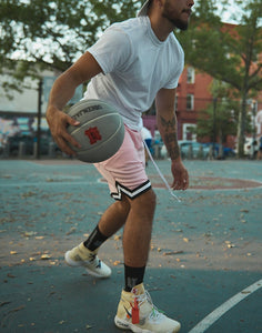 black ubeenjacked socks on model playing basketball