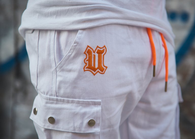 Close up UBJ logo embroidered white cargo pants