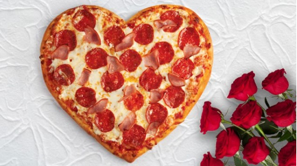 heart shaped pizza with red roses