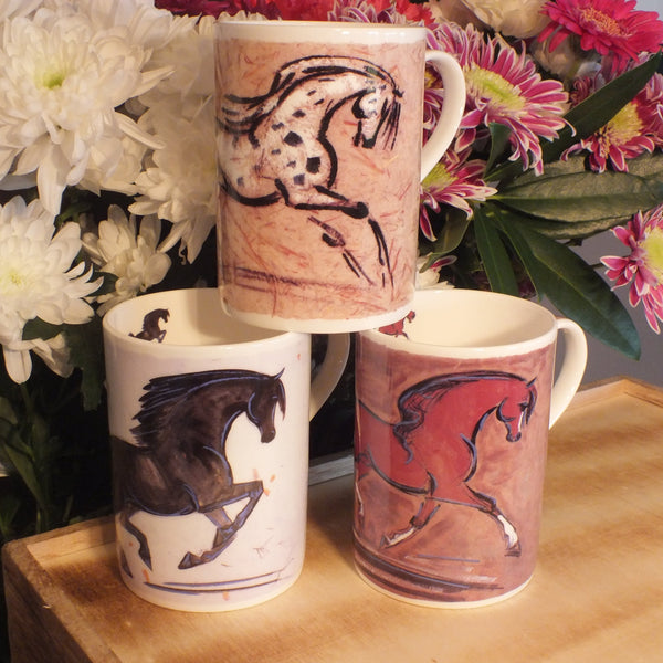 group of painted Gabriella Shaw mugs featuring horses