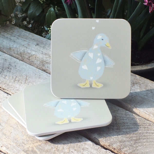 set of 4 coasters featuring blue duck with love heart pattern