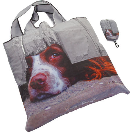 foldaway bag with spaniel peeking under fence