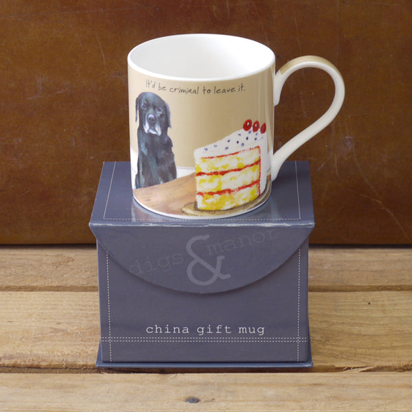 Black Labrador eyeing up some cake on a mug