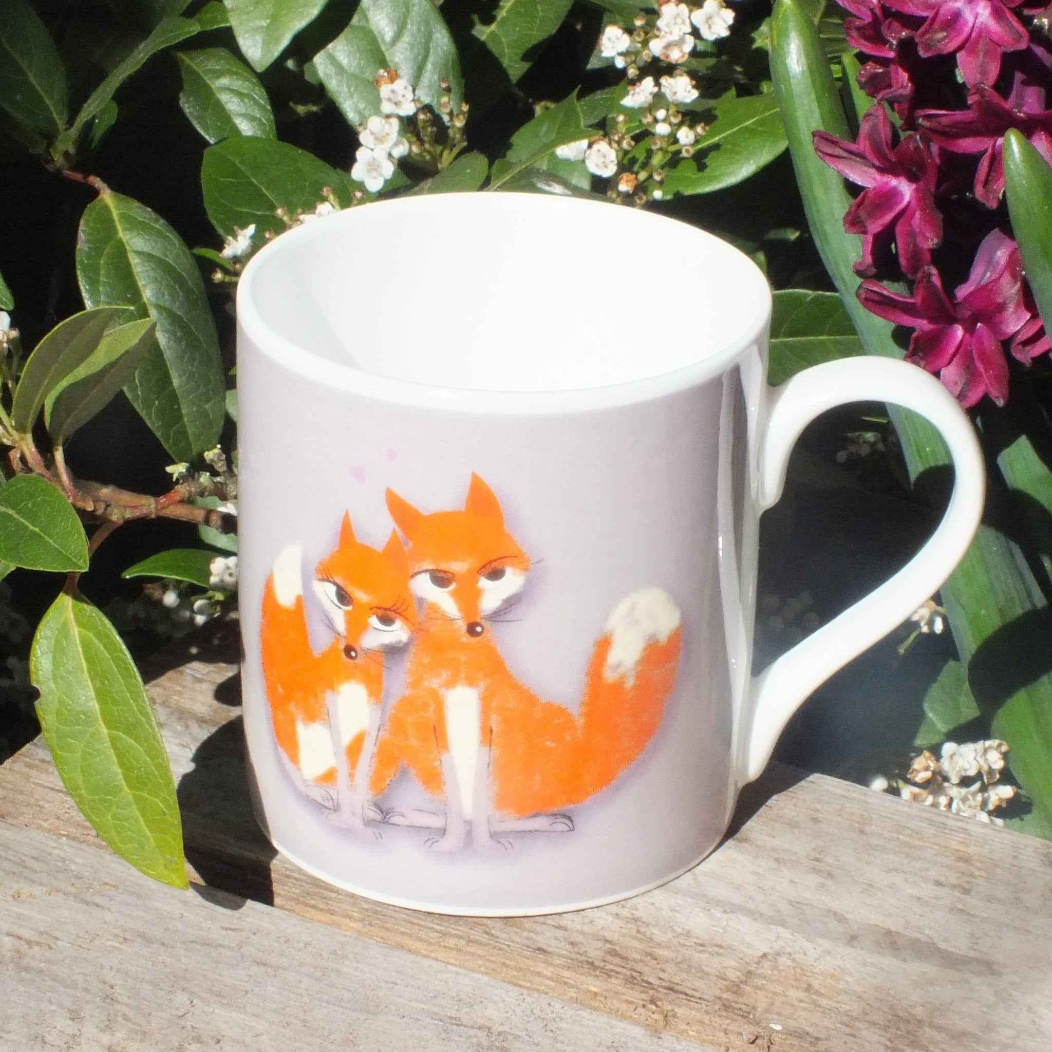 Mug featuring a couple of foxes