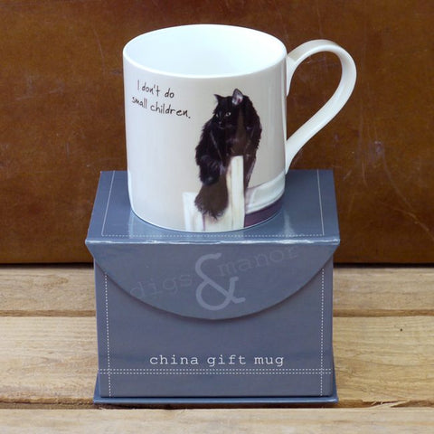 Long haired black cat sitting on doorway depicted on mug, mug sitting on top of gift box