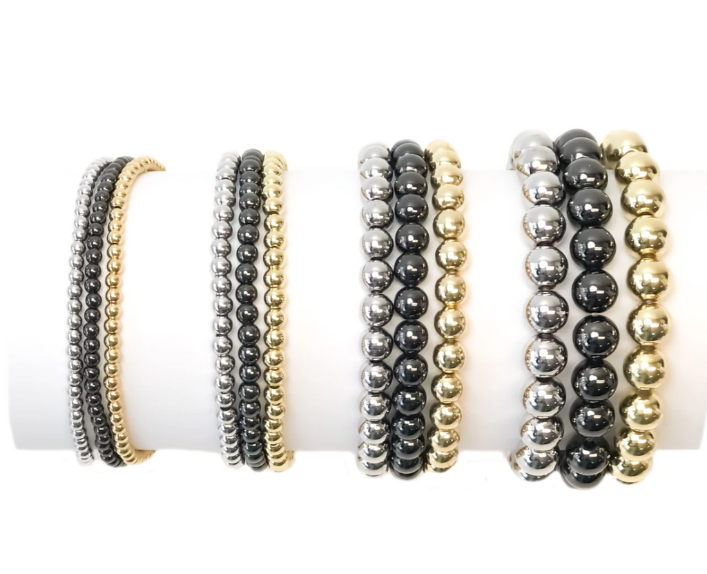 stackable beaded bracelets in gold, silver, gunmetal and rose gold