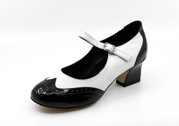 Ladies patent black & white vintage inspired wingtip, single strap, leather sole dance heel by My Juju Dance Fever.   Hand crafted with premium leather upper, leather inner, and leather sole for indoor and outdoor dancing.   6mm gel inner-sole for maximum comfort   Single strap design for a strong hold and added movement.   Premium leather sole with a 1.5 Inch heel.   Stylish & comfortable design with a fantastic level of versatility suited for most styles of dance! Now available at rockabillyaustralia.com!