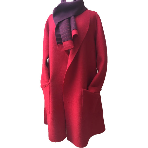 Long wool duster coat in red, edge to edge, patch pockets. Shown with matching wool scarf