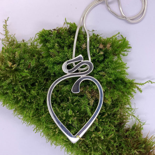 larger silver heart shaped pendant