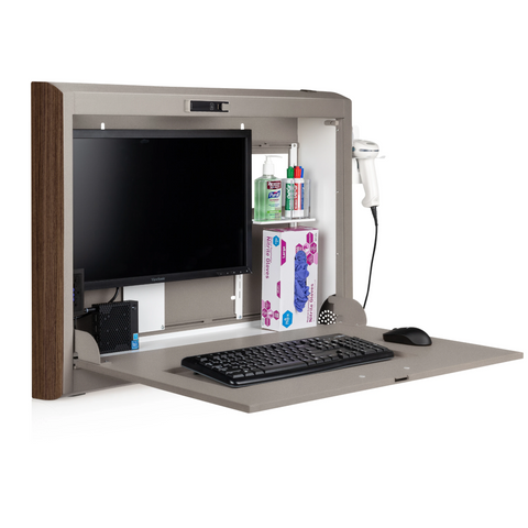 A CarePod Fixed Monitor Mount from Carstens, featuring a monitor, keyboard, mouse, scanner, and various medical supplies.