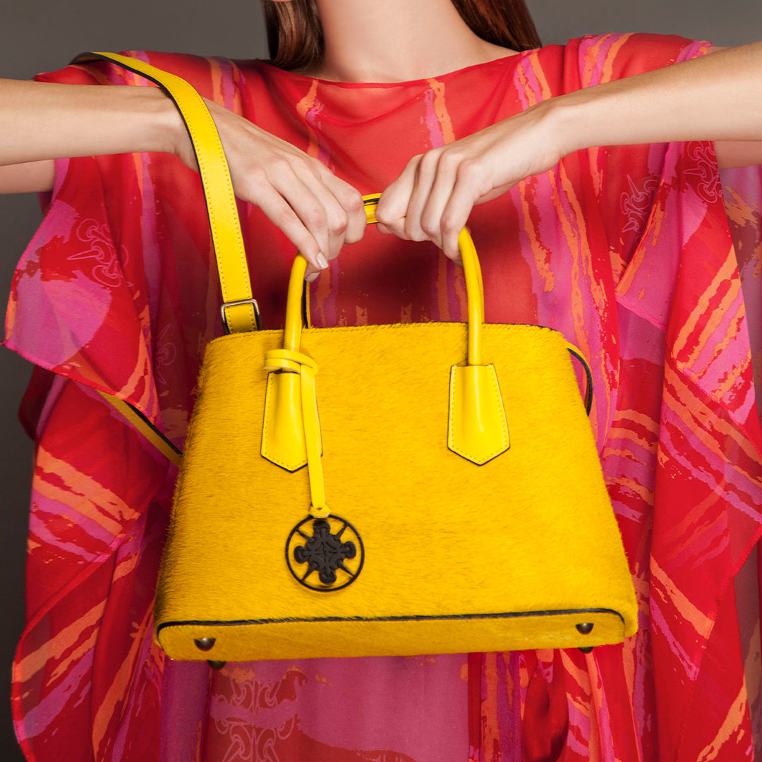 This fun, brightly colored Cavallino medium bags are perfect for any occasion. Also features a color-matched tassel and black Felizola logo. Hand Made in Italy. Yellow