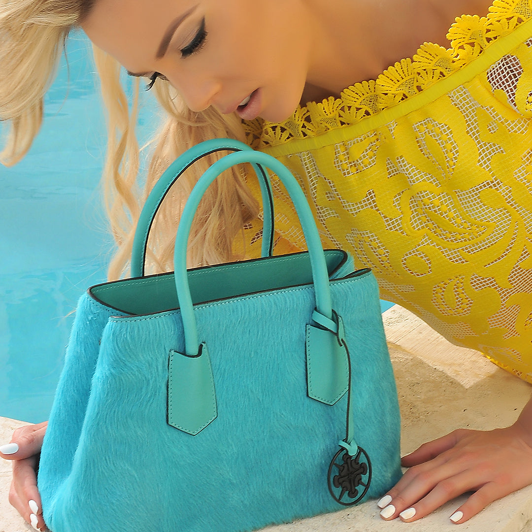 This fun, brightly colored Cavallino medium bags are perfect for any occasion. Also features a color-matched tassel and black Felizola logo. Hand Made in Italy.