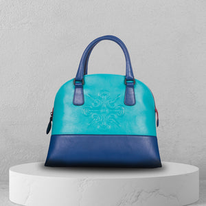Two tones of light and dark blue handbag with Nicolas Felizola logo in the middle made from fine leather