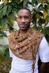 a black man wearing a brown knit cowl
