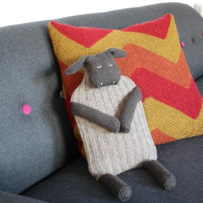 knit sheep waterbottle cover on a couch