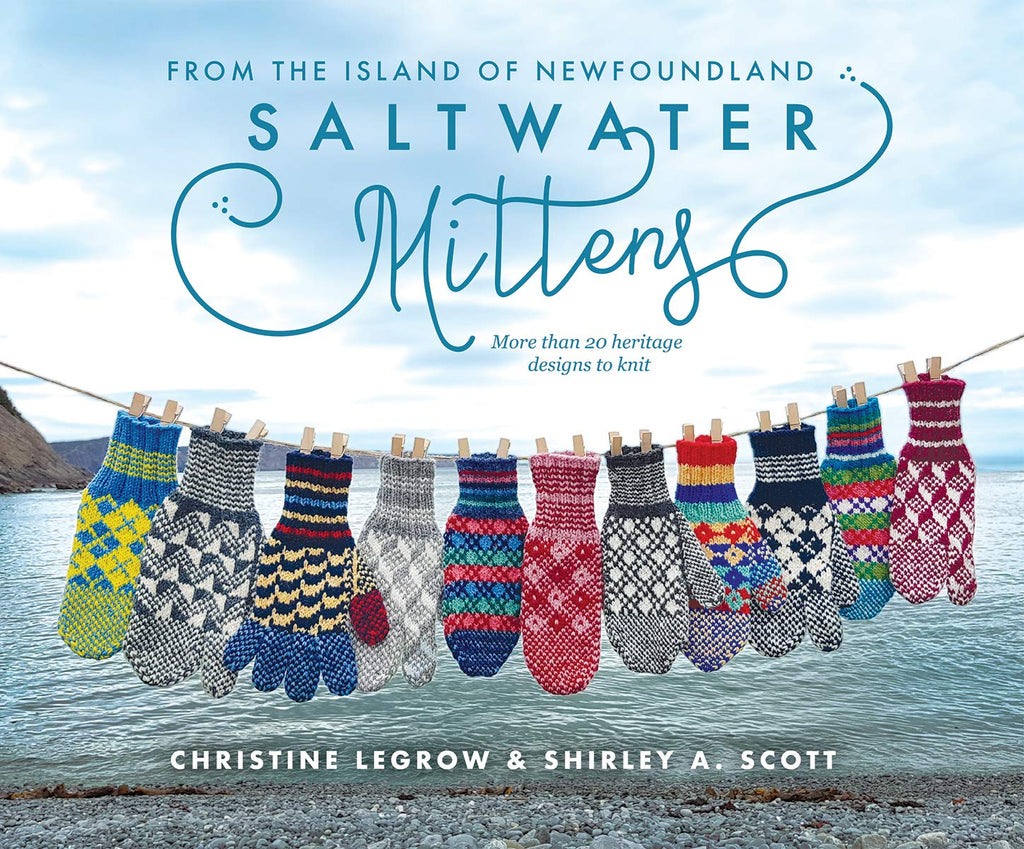 cover shot of Saltwater Mittens Book. Many various coloured colourwork mittens pinned to a clothesline on a beach.