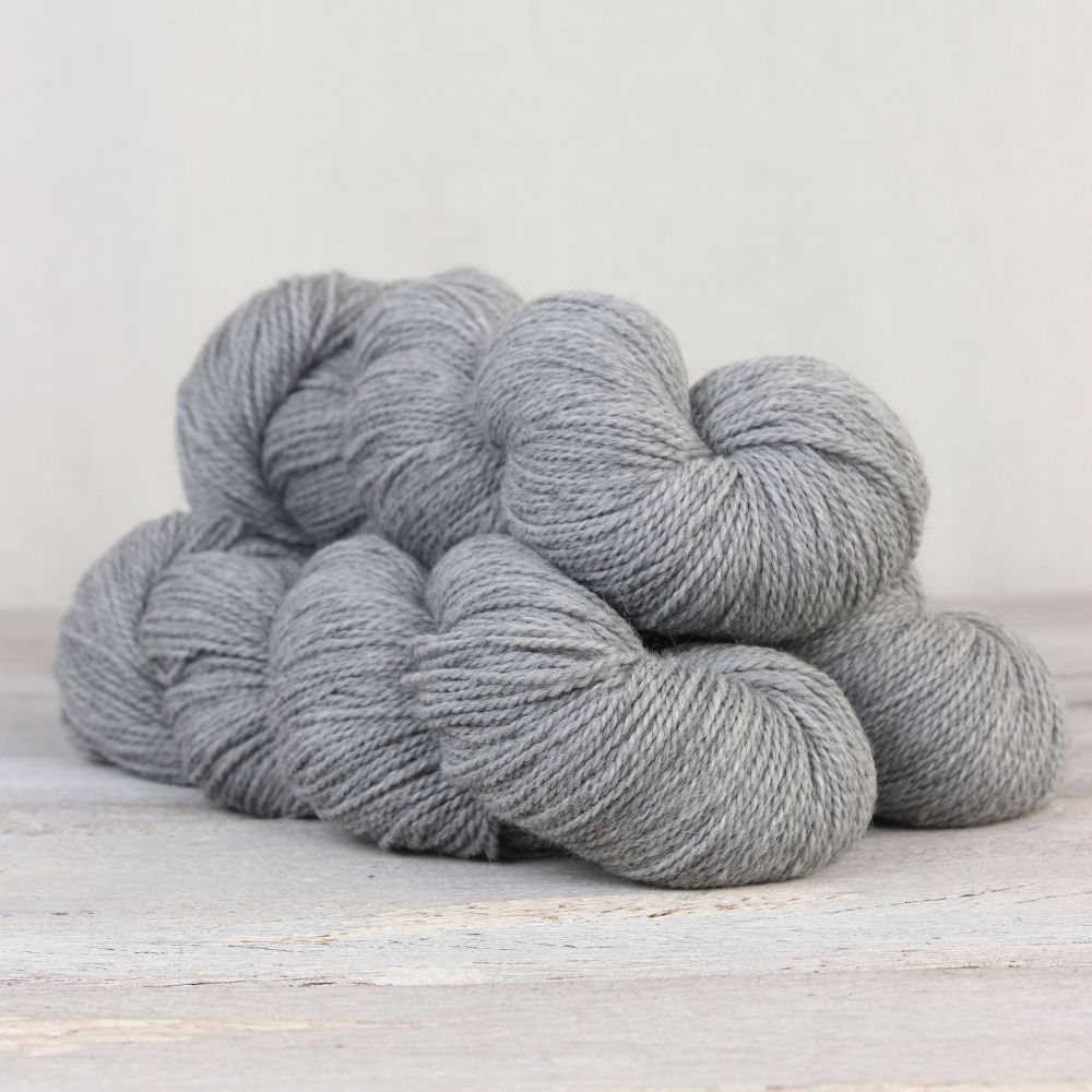 light blue-grey skeins of yarn