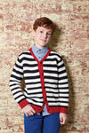 boy wearing a white and black striped knit cardigan with red trim