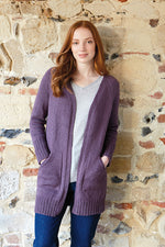 woman wearing a long purple knit cardigan