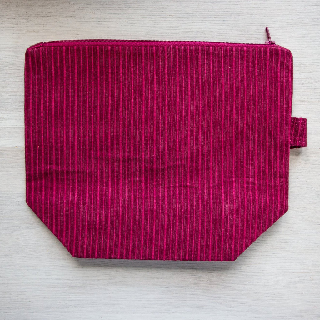 burgundy project bag with pink stripes and pink zipper
