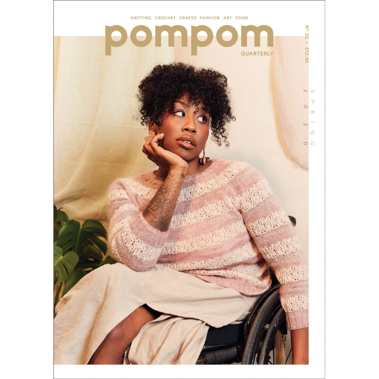 cover of pom pom quarterly issue 32. Woman in a wheelchair wearing a knit sweater striped in plain pink mohair and pink lace sections