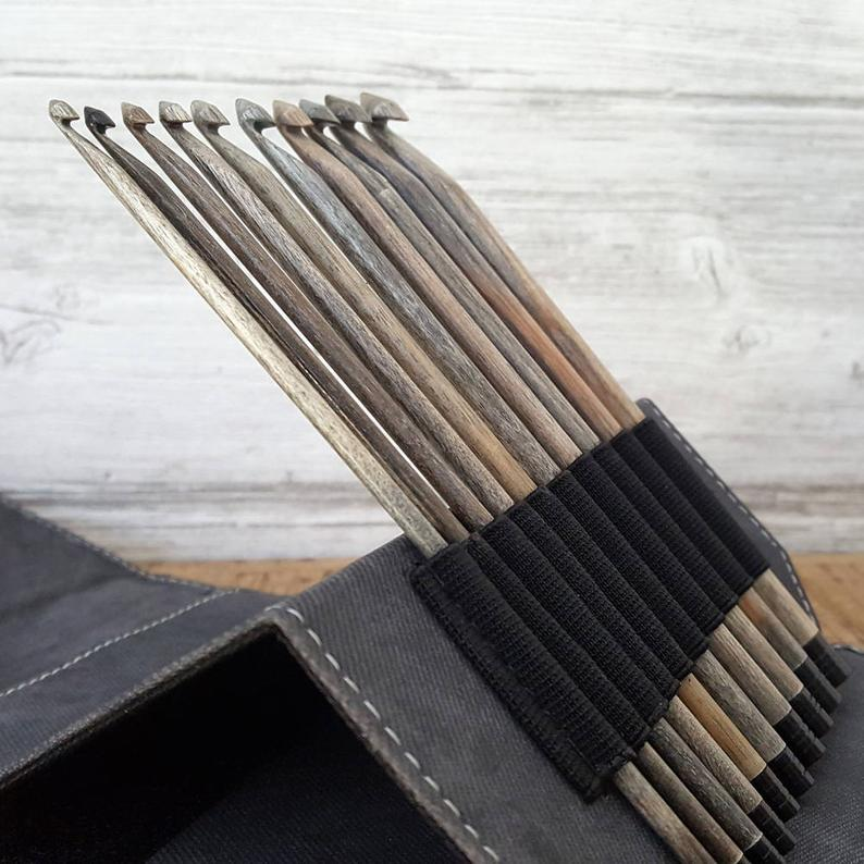 Driftwood crochet hook tips in their holders in crochet hook kit