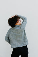grey turtleneck knit sweater with ribbing-like texture