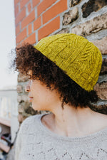 chartreuse beanie with a textured pine tree motif around the head