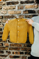 child's mustard sweater with a patterned yoke