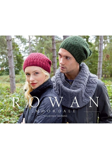 Cover of Rowan Moordale book. Man and woman standing in a forest. Both are wearing knit hats. Man is wearing a knit cabled cowl in grey