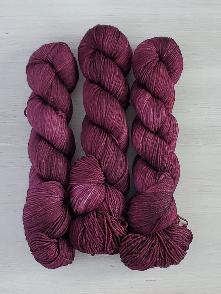 deep purple tonal skeins of yarn