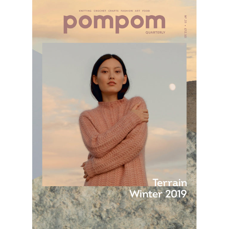 cover photo of pom pom quarterly issue 31. Woman wearing a pink funnel neck knit sweater with a textured pattern