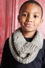 boy wearing a cabled oatmeal knit cowl