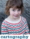 girl wearing a cream knit sweater with red and blue colourwork patterned stripes