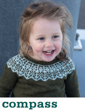 small girl wearing a green-grey knit sweater with a light blue-grey colourwork yoke