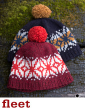 a red knit hat with a cream and orange colourwork pattern and a navy knit hat with a cream and mustard colourwork pattern