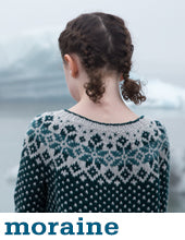 girl wearing a deep green-blue knit sweater with grey polka dots and a grey and dark teal nordic colourwork yoke