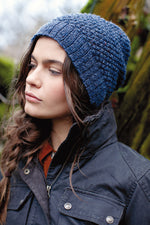woman wearing a moss-textured knit navy hat