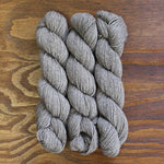 Deep natural undyed skeins of yarn