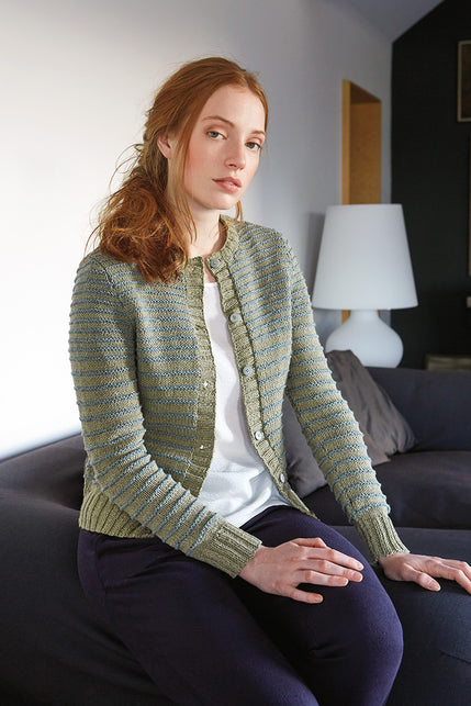 woman wearing a light green knit cardigan with blue-grey textured horizontal stripes