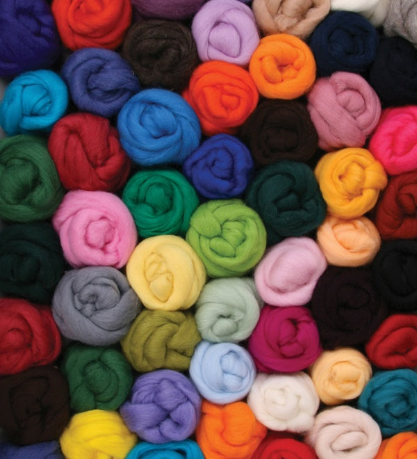 a pile of assorted coloured bumps of roving.