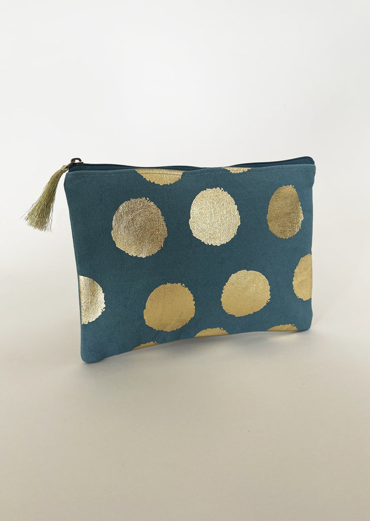 Aqua pouch bag with large gold spots and gold tassel.
