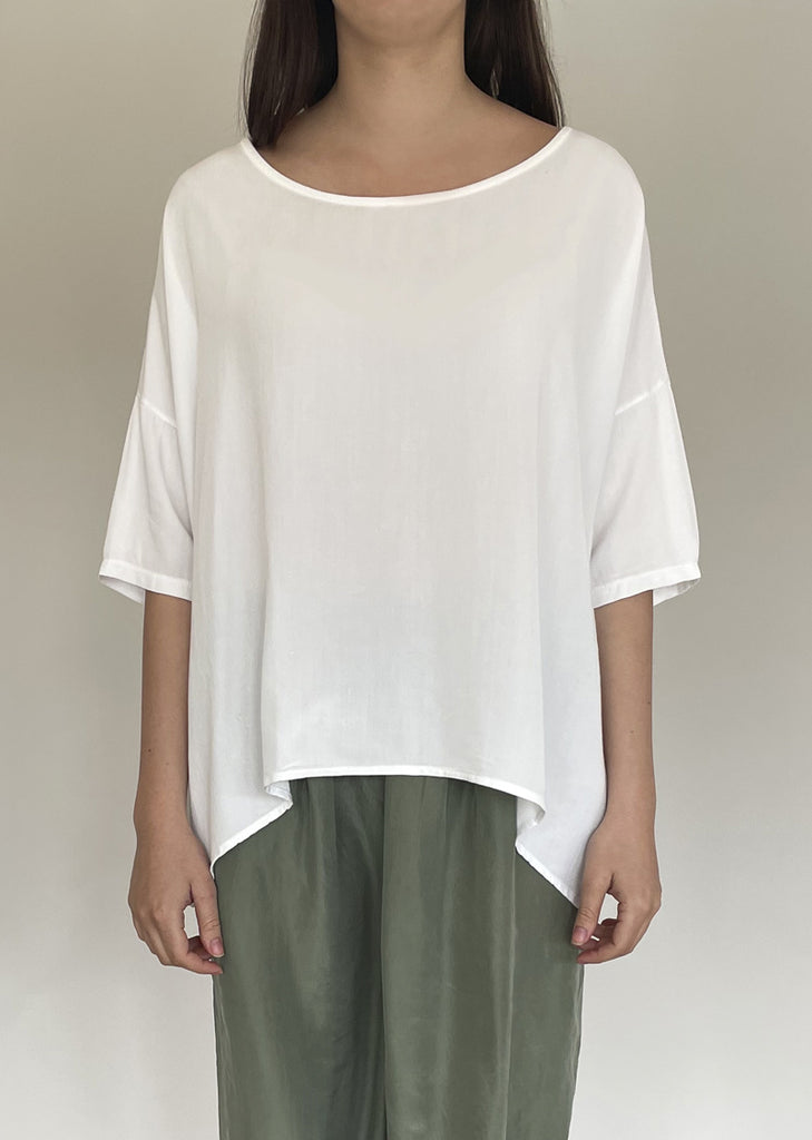 White mid-length sleeve top.