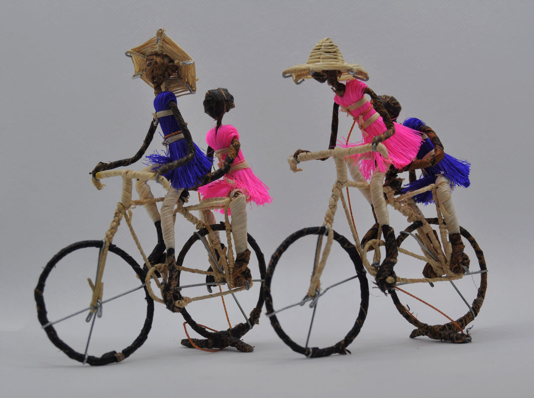 Figures on a bicyle set of 2
