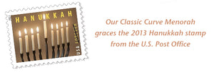 Picture of a USPS Hanukkah stamp showing a menorah from Blackthorne Forge in Vermont