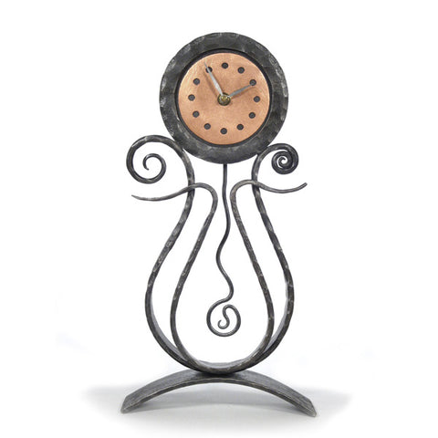 Forged iron mantle clock from Blackthorne Forge in Vermont.