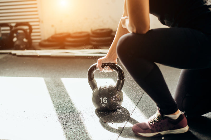 woman-lifting-kettlebell-workout