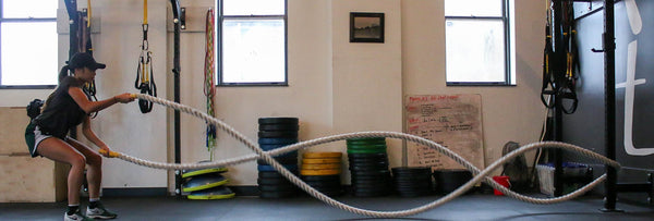 woman-battle-ropes-gym