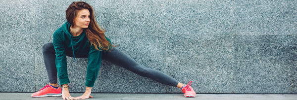 woman-stretching-workout-wear