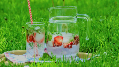 Jug of water pitcher with cold strawberry drink